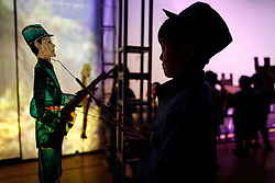 A member of 'Longzaitian' or 'Dragon in the Sky' Shadow Puppet Troupe perform with a puppet of a Chinese Communist party red army soldier in a rehearsal for a show titled 'Findling the Anti-Japanese Hero' in Beijing, China, 29 May 2015. The troupe which consists of about 50 members who look like children but are actually dwarfs with an average age of 22 and height of 1.26 metres. Formed in 2008, the troupe started out with less than ten members but gradually grew in fame and stature, drawing many other dwarfs from all parts of China who seek to be accepted in a community of their own. The troupe provides training, food, accommodation and income for the members as well as a sense of belonging and pride in their work preserving the ancient art of shadow puppetry. Dwarfs have traditionally been viewed as disabled people in China and are often discriminated by mainstream society.