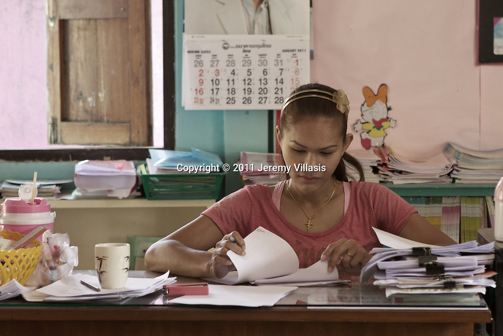 "A typical day at work for Nong Toom, more popularly known as ""The Beautiful Boxer"" at Baan Poo Yai School. In class, she also teaches basic English aside from sports."