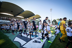 Players of both teams entering the pitch before football match between NS Mura and NK Rudar in 6th Round of 6th Round of Prva liga Telekom Slovenije 2019/20, on Avgust 18, 2019 in Fazanerija, Murska Sobota, Slovenia. Photo by Blaž Weindorfer / Sportida