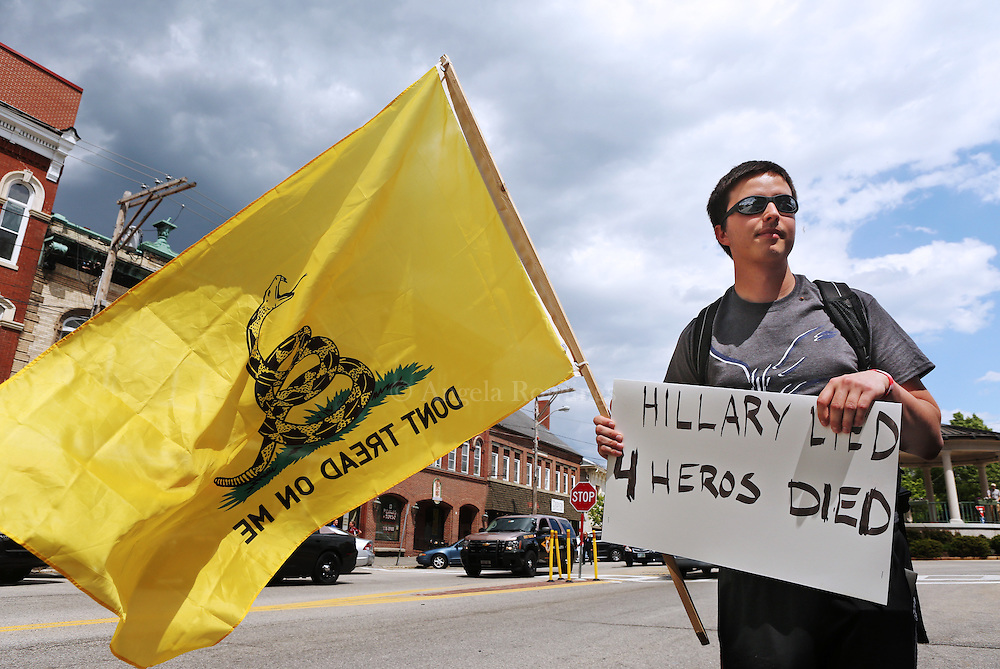 (Exeter, NH - 5/22/15) Griffin Poutre of Stratham, N.H., demonstrates along Water Street as former Secretary of State and presidential candidate Hillary Clinton makes a campaign stop in Exeter, Friday, May 22, 2015. Staff photo by Angela Rowlings.