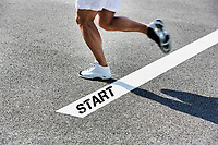 Man stepping on starting line