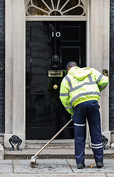 © Licensed to London News Pictures. 09/11/2017. London, UK. A street sweeper cleans up outside 10 Downing Street as Prime Minister Theresa May prepares to appoint a new Development Secretary. Photo credit: Rob Pinney/LNP