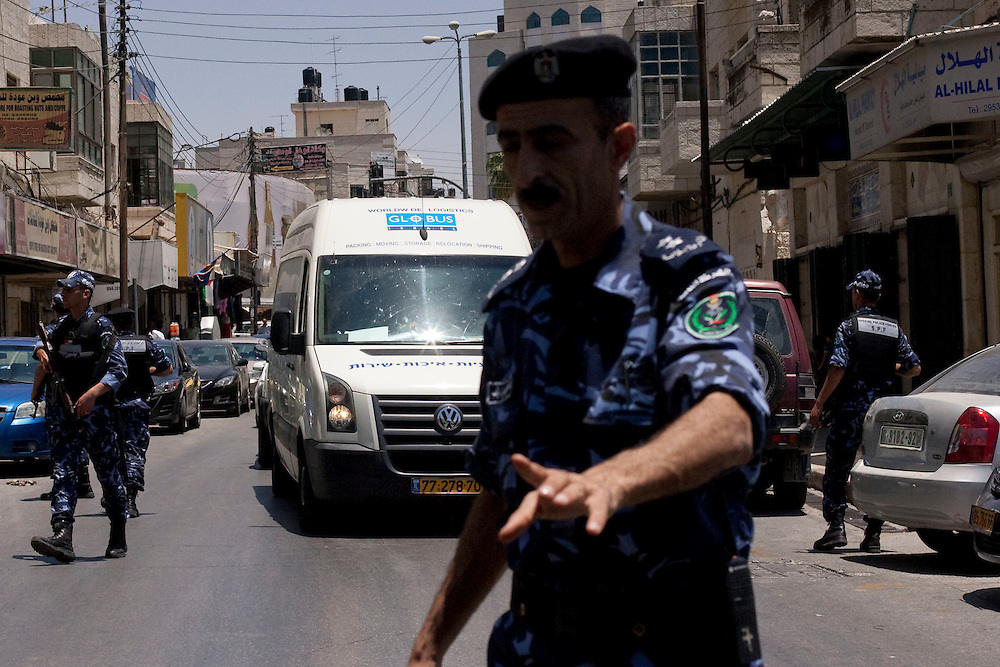 Palestinian policers secure the van transporting the Picasso paint as they arrive to the International Academy of Art of Palestine on June 19, 2011 in Ramallah...Photo by Olivier Fitoussi / Die Zeit