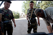 Soldiers check a car for weapons on the outskirts of Osh, June 19.