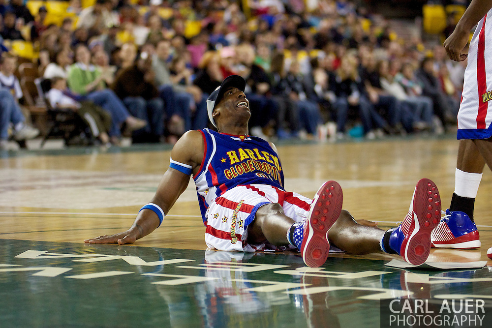 April 30th, 2010 - Anchorage, Alaska:  During a game of baseball during a timeout, Harlem Globetrotter Hi-Lite Bruton slides in safe for a inside the court home run Friday night at the Sullivan Arena.