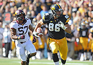 September 29 2012: Iowa Hawkeyes tight end C.J. Fiedorowicz (86) runs after a catch as Minnesota Golden Gophers linebacker Aaron Hill (57) gives chase during the first quarter of the NCAA football game between the Minnesota Golden Gophers and the Iowa Hawkeyes at Kinnick Stadium in Iowa City, Iowa on Saturday September 29, 2012. Iowa defeated Minnesota 31-13 to claim the Floyd of Rosedale Trophy.