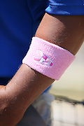 LOS ANGELES, CA - MAY 12:  A Los Angeles Dodgers player wears a pink wrist band in honor of Mother's Day during the game against the Miami Marlins on Sunday, May 12, 2013 at Dodger Stadium in Los Angeles, California. The Dodgers won the game 5-3. (Photo by Paul Spinelli/MLB Photos via Getty Images)
