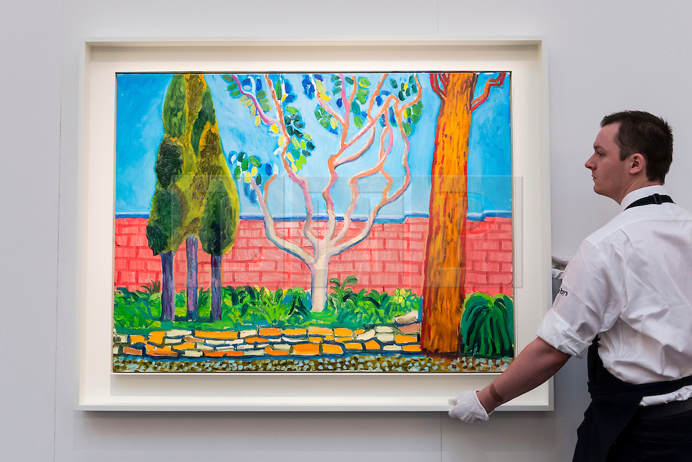 "© Licensed to London News Pictures. 30/09/2016. London, UK.  ""Guest House Wall"" by David Hockney (est. GBP1.8-2.5 million) is checked by a technician at the preview of Sotheby's London upcoming Contemporary Art Auctions.  Photo credit : Stephen Chung/LNP"