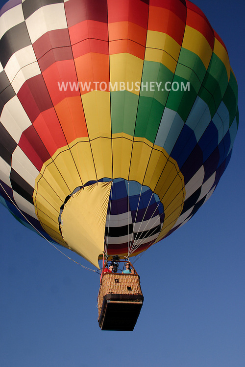 A hot air balloon takes off from Randall Airport in Middletown, NY, on July 2, 2005.