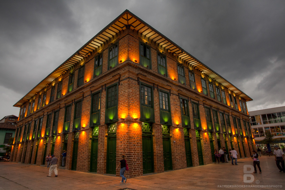 A brightly lit building in Plaza Cisneros in Medellin, Colombia.