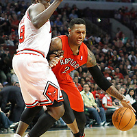 24 March 2012: Toronto Raptors small forward James Johnson (2) drives past Chicago Bulls small forward Luol Deng (9) during the Chicago Bulls 102-101 victory in overtime over the Toronto Raptors at the United Center, Chicago, Illinois, USA.