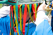 Woman age 25 adjusting her head puppet before beginning of parade. MayDay Parade and Festival. Minneapolis Minnesota USA