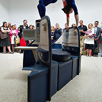 VENICE, ITALY - JUNE 01:  A female gymnast balances on a Delta Air Lines seat installation byJennifer Allora and Guillermo Calzadilla at the US Pavillion of the Giardini Biennale on June 1, 2011 in Venice, Italy. This year's Biennale is the 54th edition and will run from  June 4th until 27 Novembe  (Photo by Marco Secchi/Getty Images)