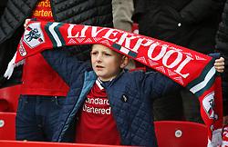 A Liverpool fan holds up a scarf before kick off - Mandatory by-line: Matt McNulty/JMP - 28/10/2017 - FOOTBALL - Anfield - Liverpool, England - Liverpool v Huddersfield Town - Premier League