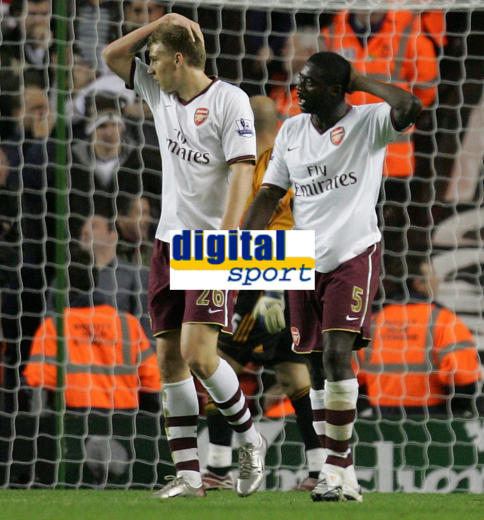 Photo: Paul Thomas.<br /> Liverpool v Arsenal. The FA Barclays Premiership. 28/10/2007.<br /> <br /> Arsenal players hold their heads in dispear, Nicklas Bendtner (L) and Kolo Toure (5) after they come close to scoring at the end. *** Local Caption *** *** UK ONLY ***
