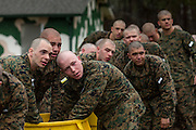 US Marine recruits listen to commands during decontamination after exiting the gas chamber during bootcamp January 13, 2014 in Parris Island, SC.