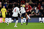 Mohamed Salah (11) of Liverpool battles for possession with Jack Simpson (25) of AFC Bournemouth during the Premier League match between Bournemouth and Liverpool at the Vitality Stadium, Bournemouth, England on 7 December 2019.