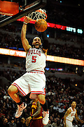 1/22/11 Chicago,IL<br /> Bulls forward Carlos Boozer screams as he slam dunks the ball in the second half of of Chicago's 92-79 win over the Cleveland Cavaliers at the United Center in Chicago on Jan. 22, 2011. | Rob Hart~Sun Times Media