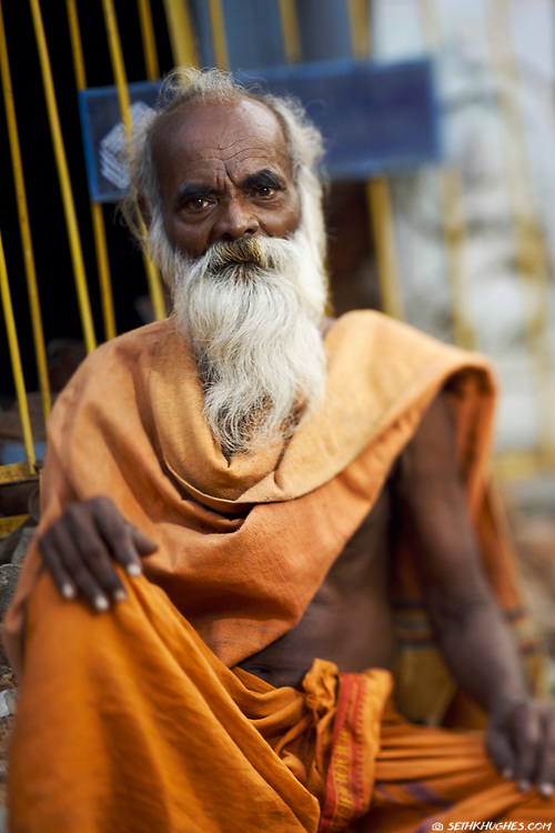 A sadhu sits and awaits alms in the venerated town of Thiruvannamalai, Tamil Nadu, India. Sadhus are renunciates who have abandoned all material and sexual attachments to live in caves, forests and temples all over India in the pursuit of Moksha (liberation). December 27, 2007