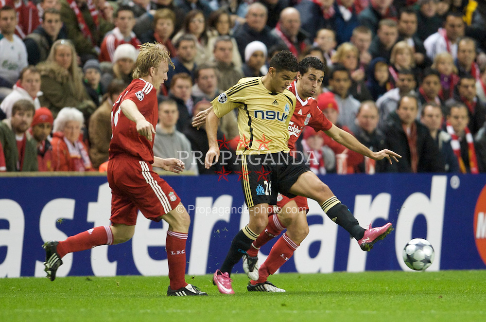 LIVERPOOL, - Wednesday, November 26, 2008: Liverpool's Alvaro Arbeloa and Dirk Kuyt and Olympique de Marseille's Hatem Ben Arfa during the UEFA Champions League Group D match at Anfield. (Photo by David Rawcliffe/Propaganda)