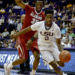 Jan 14, 2017; Baton Rouge, LA, USA; LSU Tigers guard Antonio Blakeney (2) drives past Alabama Crimson Tide forward Donta Hall (35) during the second half of a game at the Pete Maravich Assembly Center. Alabama defeated LSU 81-66. Mandatory Credit: Derick E. Hingle-USA TODAY Sports