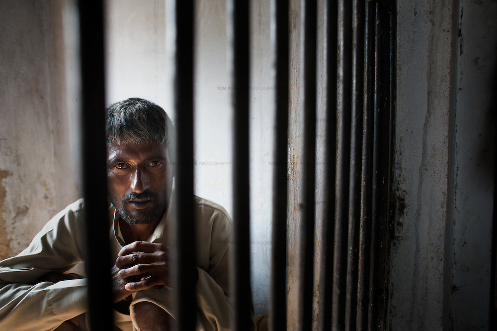 Dasarath Mogia in his cell at the Faludi Forest Department range office on the edge of Ranthambore National Park. Dasarath, an ex-poacher who handed himself into forest officials, had just spent his first night in custody. It is alleged that Dasarath was beaten by forest guards during his first night in custody. Tiger Watch encourage poachers - many of them, including Dasarath, from the ostracised Mogia caste - to submit to the authorities by offering them and their families financial support and assistance with alternative livelihoods...Sariska National Park in Rajasthan was once home to dozens of tigers but by 2005 poaching had resulted in their complete eradication. Recognising the urgent need for intervention, the Indian and Rajasthan-state governments began the reintroduction of tigers into Sariska. Two cats were airlifted 200 km from Ranthambore National Park in June 2008. On November 5th an attempt to relocate a third tiger was postponed until later in the month. This relocation strategy is certainly an important part of the tiger conservation effort but many, including those like Dharmendra Khandal of the NGO Tiger Watch, argue that it will never be entirely successful without properly confronting the three essential issues that threaten tiger populations: poaching, habitat loss and the hunting of prey-base animals. In turn, these three issues cannot be addressed without acknowledging the malign influence of caste, poverty and poor administrative accountability. Poaching is almost exclusively undertaken by extremely poor and marginalised groups, including the Mogia caste who, without education, land and access to credit have limited alternative means of income. Many in the Mogia community also hunt bush meat for both their own consumption and to sell to others. This results in a depletion of the prey-base upon which tigers feed. Encroachment and grazing by those including the Gujar people who raise dairy herds, have led to habitat loss in Sariska and other p