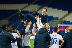 CARDIFF, WALES - Tuesday, August 21, 2014: England's manager Mark Sampson is thrown in the air by his players after the 4-0 victory over Wales during the FIFA Women's World Cup Canada 2015 Qualifying Group 6 match at the Cardiff City Stadium. (Pic by David Rawcliffe/Propaganda)