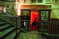 France. Paris 18th; people on Montmartre stairs, Rue drevet at night; Au petit theatre du Bonheur.