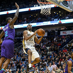 Mar 13, 2018; New Orleans, LA, USA; New Orleans Pelicans forward E'Twaun Moore (55) shoots as Charlotte Hornets forward Marvin Williams (2) defends during the third quarter of a game at the Smoothie King Center. The Pelicans defeated the Hornets 119-115.  Mandatory Credit: Derick E. Hingle-USA TODAY Sports