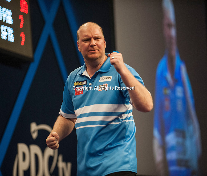 30.12.2014.  London, England.  William Hill PDC World Darts Championship.  Vincent van der Voort (23) [NED] celebrates a finish during his game with Dean Winstanley (26) [ENG]. Vincent van der Voort won the match 4-2.