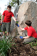 Jordan Lealos, 16 (left) and Brian Daigle, 12 during a cleanup of the Victory Oak Knoll Memorial near the entrance of Dayton's Community Golf Course (at the edge of Kettering) by Boy Scout Troop 193, Saturday, May 7, 2011.