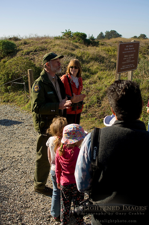 Volunteer docent leading tourists through Elepahnt Seal Colony, Ano Nuevo State Reserve San Mateo County coast, California