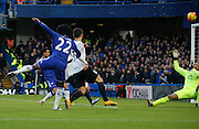 Chelsea attacker Willian fires a shot towards Everton goalkeeper Tim Howard forcing him in to a great save during the Barclays Premier League match between Chelsea and Everton at Stamford Bridge, London, England on 16 January 2016. Photo by Andy Walter.