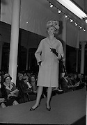 09/03/1964<br /> 03/09/1964<br /> 09 March 1964<br /> McBirney's Fashion show at McBirney's, Aston Quay, Dublin. Model Blanche wearing a pink coat, hat and gloves from the collection.