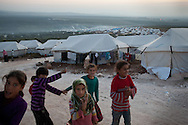 Syrian girls play in Atmeh refugee camp, for internally displaced Syrians. Around 12,000 IDP now live in the camp. December 2nd 2012, Atmeh, Syria.