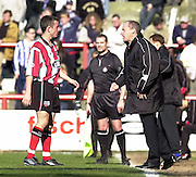 .Photo Peter Spurrier.06/04/2002.Nationwide Div 2.Brentford vs Huddersfield - Griffen Park:.Brentford manager Steve Coppell instructs to Bee's captain Stephen Hunt..