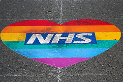 © Licensed to London News Pictures. 15/05/2020. London, UK.  A rainbow coloured heart shape with NHS written in it on a north London road to show appreciation for the efforts of NHS staff, carers and key workers during the COVID-19 pandemic. Photo credit: Dinendra Haria/LNP