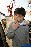Akira Tamura, a member of the so-called Fukushima 50 is given a radiation check prior to boarding the Kaiwomaru in the dock at Onahama Port, Iwaki City, Fukushima Prefecture on  23 March 20011.  .Photographer: Robert Gilhooly