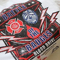Blood donors receive a free T-shirt for participating in this year's Battle of Badges Blood Drive.
