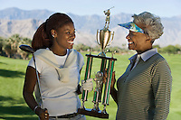 Grandmother and Granddaughter Holding Golf Trophy