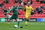 AFC Wimbledon striker Lyle Taylor (33) chasing down Charlton Athletic goalkeeper Ben Amos (1) during the EFL Sky Bet League 1 match between Charlton Athletic and AFC Wimbledon at The Valley, London, England on 28 October 2017. Photo by Matthew Redman.