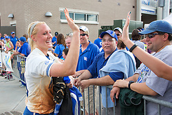 UK first baseman Lauren Cumbess, left, is congratulated by fans after winning the KY Regional Championship Game of the 2013 NCAA D1 Softball Tournament, Sunday, May 19, 2013 at John Cropp Stadium in Lexington. Photo by Jonathan Palmer