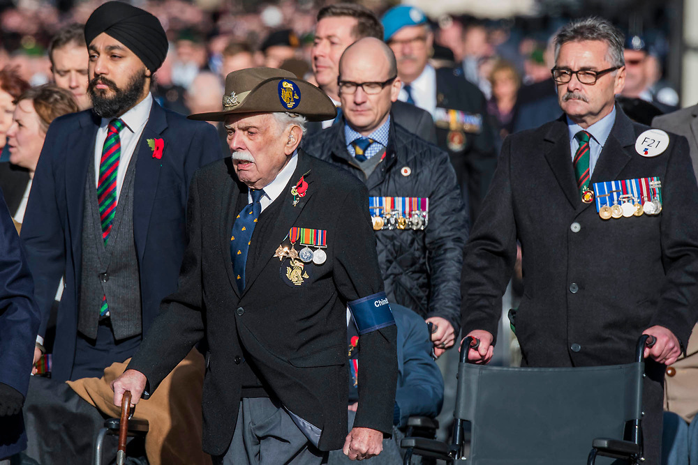 Veterans, incl a Chindit who refuese to use his wheelchair, march past the Cenothaph and down Whitehall - Remembrance Sunday and Armistice Day commemorations fall on the same day, remembering the fallen of all conflicts but particularly the centenary of the end of World War One.