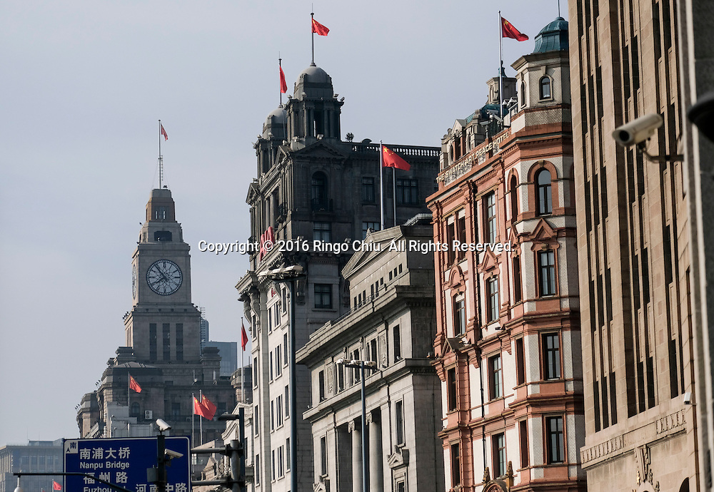 Western-style architectures along the Bund in Shanghai, China. Shanghai is the most populous city in China and the most populous city proper in the world. It is one of the four direct-controlled municipalities of China, with a population of more than 24 million as of 2014. It is a global financial centre, and a transport hub with the world's busiest container port. Located in the Yangtze River Delta in East China, Shanghai sits on the south edge of the mouth of the Yangtze in the middle portion of the Chinese coast. The municipality borders the provinces of Jiangsu and Zhejiang to the north, south and west, and is bounded to the east by the East China Sea. A major administrative, shipping, and trading town, Shanghai grew in importance in the 19th century due to trade and recognition of its favourable port location and economic potential. The city was one of five forced open to foreign trade following the British victory over China in the First Opium War while the subsequent 1842 Treaty of Nanking and 1844 Treaty of Whampoa allowed the establishment of the Shanghai International Settlement and the French Concession. The city then flourished as a center of commerce between China and other parts of the world (predominantly Western countries), and became the primary financial hub of the Asia-Pacific region in the 1930s. However, with the Communist Party takeover of the mainland in 1949, trade was limited to socialist countries, and the city's global influence declined. In the 1990s, the economic reforms introduced by Deng Xiaoping resulted in an intense re-development of the city, aiding the return of finance and foreign investment to the city. Shanghai has been described as the &quot;showpiece&quot; of the booming economy of mainland China; renowned for its Lujiazui skyline, museums and historic buildings, such as those along The Bund, the City God Temple and the Yu Garden.(Photo by Ringo Chiu/PHOTOFORMULA.com)<br /> <br /> Usage Notes: This content is intended for editorial use only. For o