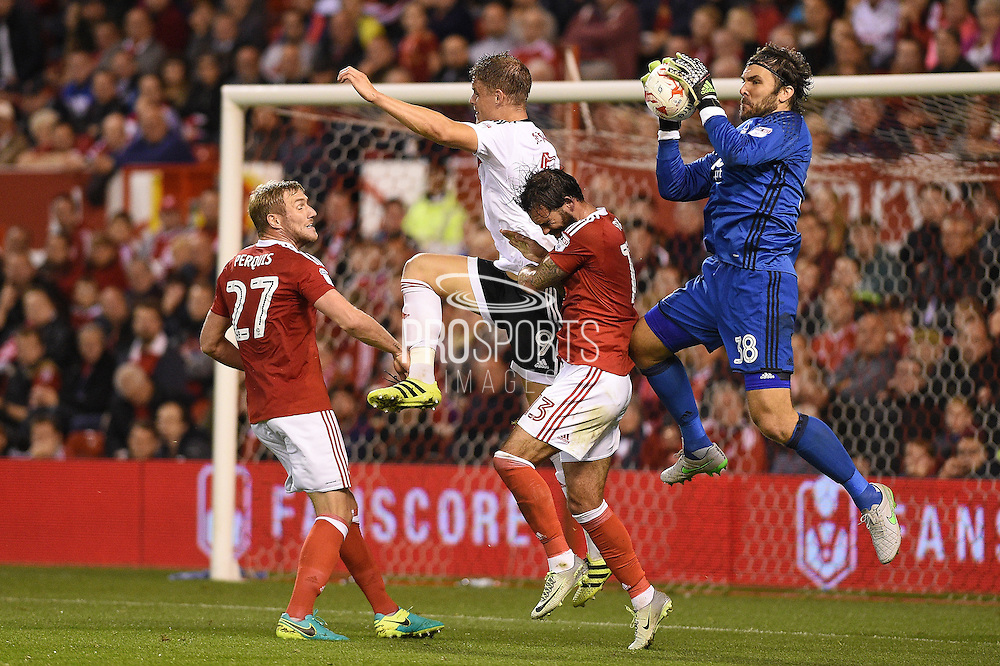 Nottingham Forest goalkeeper Vladimir Stojkovic (38) makes a save during the EFL Sky Bet Championship match between Nottingham Forest and Fulham at the City Ground, Nottingham, England on 27 September 2016. Photo by Jon Hobley.