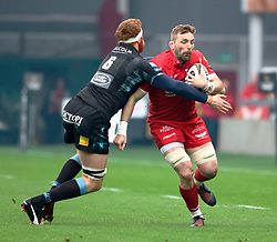 Scarlets' John Barclay is tackled by Glasgow Warriors' Rob Harley<br /> <br /> Photographer Simon King/Replay Images<br /> <br /> Guinness PRO14 Round 19 - Scarlets v Glasgow Warriors - Saturday 7th April 2018 - Parc Y Scarlets - Llanelli<br /> <br /> World Copyright © Replay Images . All rights reserved. info@replayimages.co.uk - http://replayimages.co.uk