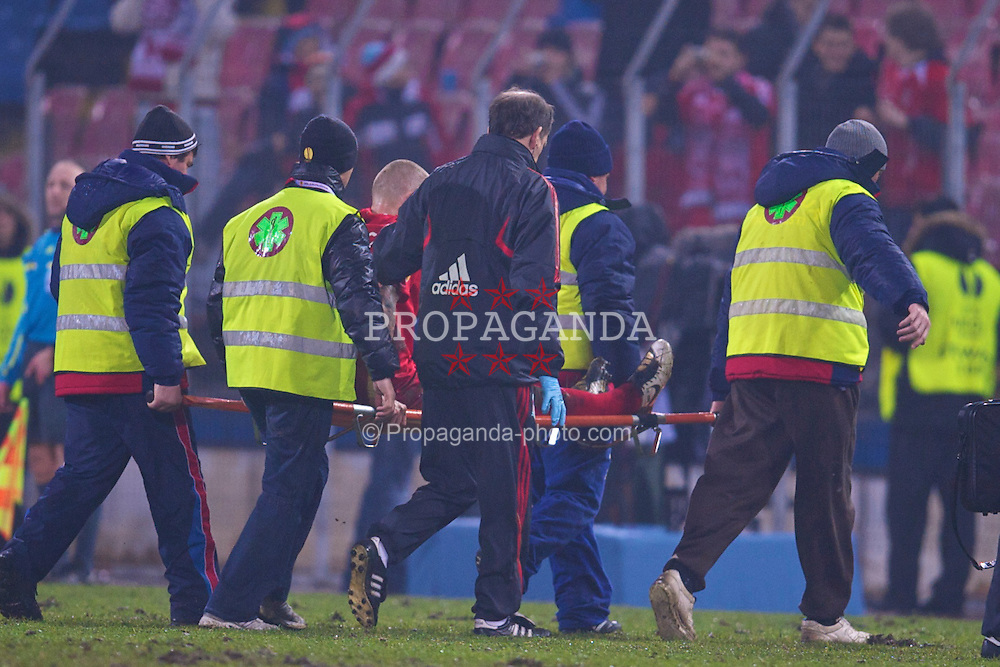 BUCHAREST, ROMANIA - Thursday, February 25, 2010: Liverpool's Martin Skrtel is carred off injured during the UEFA Europa League Round of 32 2nd Leg match at the Steaua Stadium. (Photo by David Rawcliffe/Propaganda)