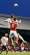 Kirk Broadfoot challanging in the air during the Sky Bet Championship match between Fulham and Rotherham United at Craven Cottage, London, England on 15 April 2015. Photo by Matthew Redman.