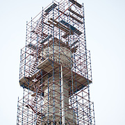 Scaffolding surrounds one of the six minarets of the Blue Mosque for repairs. While it is widely known as the Blue Mosque for the its interior tiling, the mosque's formal name is Sultan Ahmed Mosque (or Sultan Ahmet Camii in Turkish). It was built from 1609 to 1616 during the rule of Sultan Ahmed I.
