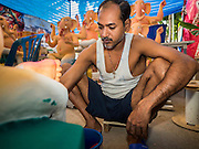 "09 SEPTEMBER 2015 - BANGKOK, THAILAND:  A craftsman at the Vishnu Temple in Bangkok works on a statue of Ganesha, an important Hindu deity known as the ""overcomer of obstacles."" Ganesha Chaturthi is the Hindu festival celebrated on the day of the re-birth of Lord Ganesha, the son of Shiva and Parvati. Ganesha is widely revered as the patron of arts and sciences and the deva of intellect and wisdom. The last day of the festival is marked by the immersion of the deity in nearby bodies of water. The immersion symbolizes the cycle of creation and dissolution in nature. The deities made at the Vishnu Temple in Bangkok will be submerged in rivers and streams across Thailand at several Ganesha festivals held in September.        PHOTO BY JACK KURTZ"
